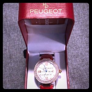 Peugeot rose gold watch with red leather band